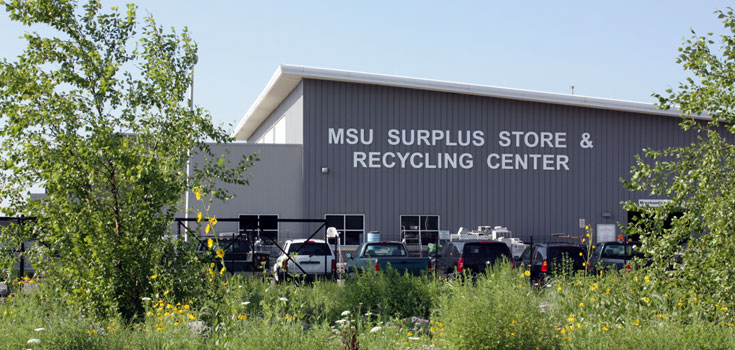 A spring time photo of the MSU Surplus Store and Recycling Center