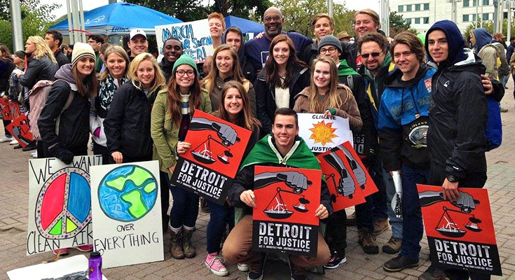 A photo of the Spartan Sierra club gathered at an environmental justice rally in Detroit, Michigan.