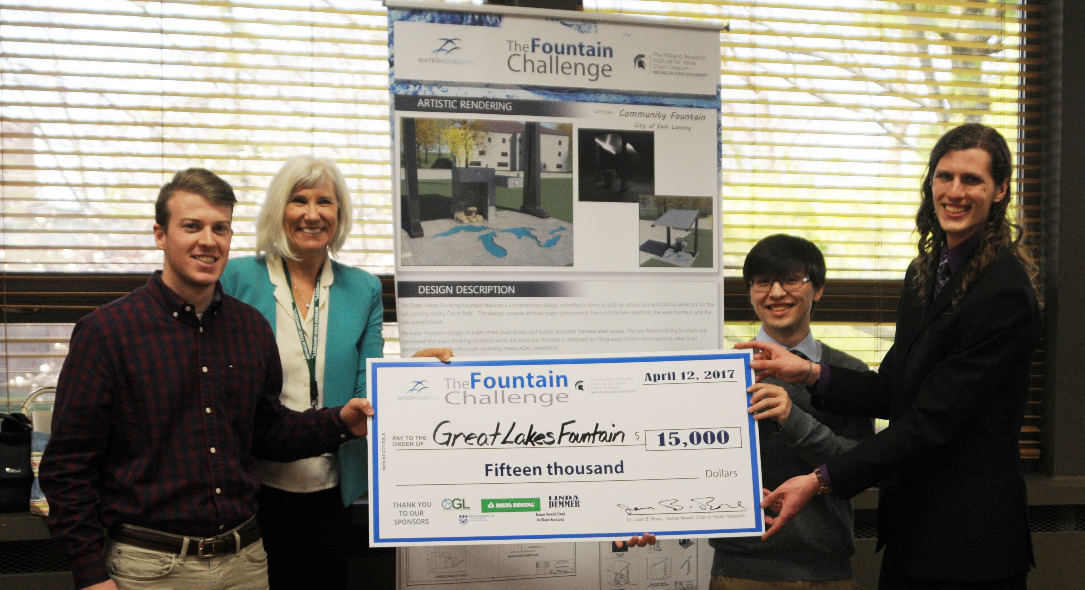 A photo of the winners of the Fountain Challenging holding their prize check for $15,000.