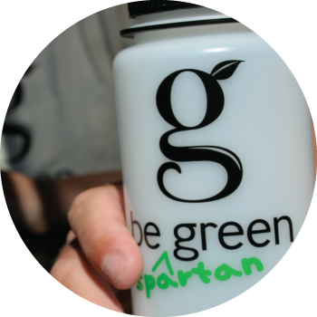 "A photo of a water bottle with text reading ""Be Spartan Green."""