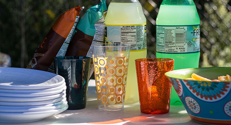 A photo of plastic dishware and refreshments.