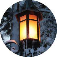 A photo of a bright, snowy lantern on MSU's campus during the winter.